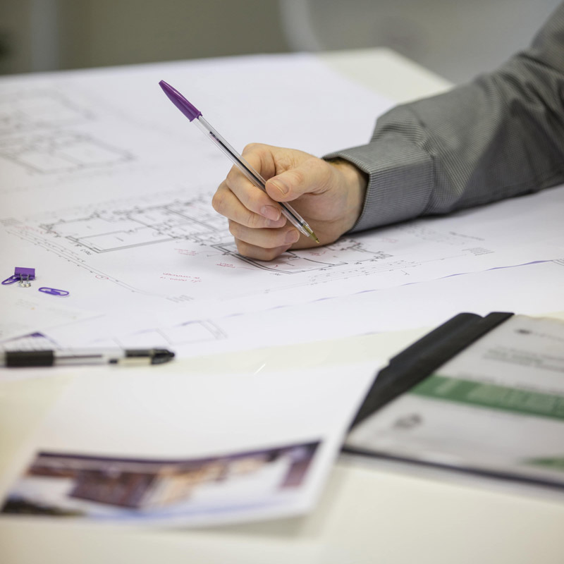 Picture of architectural designer checking drawings Malton office, Yorkshire.