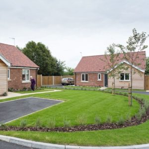 Photo of completed new build development of seven bungalows, Thurlton, Norfolk.