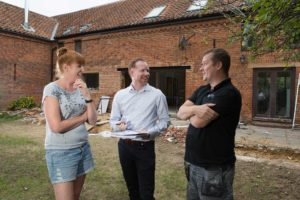 Architecture and planning clients outside barn conversion reconfiguration project, Norfolk