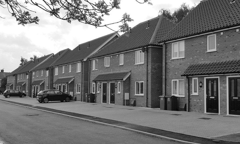 Photo of completed new build development of three-bedroom private and affordable homes, Thorpe St Andrew, Norwich. Copyright Fusion 13