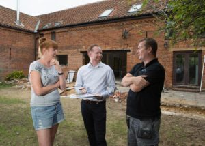 Picture of Lee Marsh with clients on site at Owls Barn, Reedham.