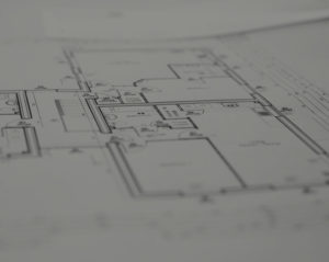 Abstract photo of housing association planning drawings.